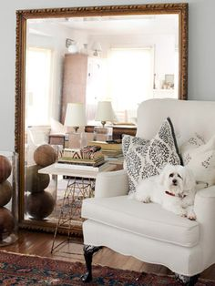 Sitting Pretty - Love the Oversized Mirror leaning against the wall, and the adorable dog in the chair.