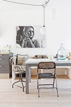 Industrial style dining room complete with photo of Brigitte Bardot. | Photo: Hans Mossel | Styling: Sabine Burkunk | Story: Real Living