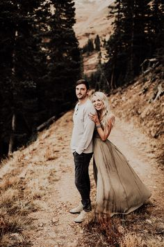 Josh and Danyelle | Loveland Pass Colorado Engagement Photographer | elsaeileenphotography.com Colorado engagement photos, Colorado, Colorado Mountains, Rocky Mountain Engagement photography, Mountain engagement pictures. Moody Engagement photos, what to wear, flowy dress, Engagement Style, Outfit Inspiration, boho engagement session, Fall engagement photos, green maxi dress. Romantic, sweet, and candid engagement picture ideas. Moody and Warm. Breckenridge engagement photographer