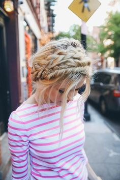 Braided and twisted crown hairstyle tutorial on blonde hair. Pretty girl with pink and white stripe jersey tee.