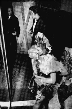 New York, New York, March 17, 1956   Elvis backstage at CBS-TV's Studio 50 with members of the June Taylor Dancers waiting to perform on the Dorsey Brothers' 'Stage Show' program