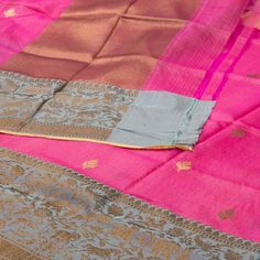 """The """"Deep #Pink"""" #handwoven #Banarasi #Silk #Sari from Sailesh Singhania is woven with gold zari floral bhutas all over the body that is set off by a slate grey with zari floral motifs border. An attractive gold zari adorn the pink pallu. The border is repeated on the deep pink blouse that completes the sari."""