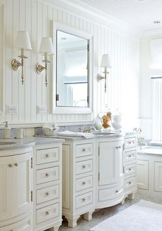 Charming bathroom with beadboard walls & curved cabinets