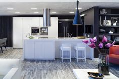 White kitchen gray wood floor dark cabinet