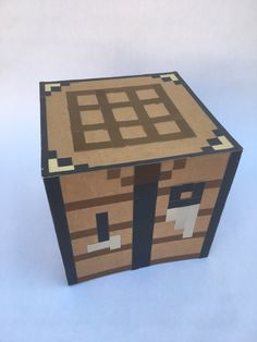 A fun Minecraft inspired crafting table tabletop decoration. Great for party centerpieces or decoration for your room or desk. Lightweight and open on the bottom possibly for hiding surprises or gifts. Approximately 7.25 cube.  I create each box to order with high quality, heavyweight scrapbook paper, completely sealed with Modge Podge to give it a bit of extra shine and protection. I used these as table centerpieces at my sons recent Minecraft themed party and they were a huge hit!   NOT…