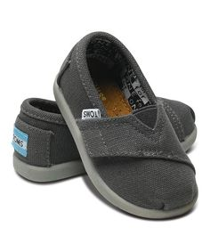 It's as easy to slip this shoe on little feet as it is to make a big difference. TOMS' classic styling with its toe-stitch and elastic V goring gets kid-size perks like a flexible rubber cupsole and adjustable strap for the perfect, snug fit. And with every pair of TOMS shoes purchased, another pair is donated to a child in need.Size note: TOMS run true to size. If your child is...