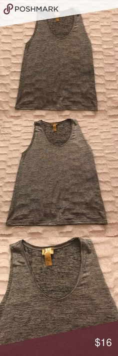 Silver H&M Tank Top Size US 6 Silver H&M tank top. Size US 6. Worn once. In like new condition. There isn't a blue stain like in the picture that's from the camera. The last 2 pictures came out right and shows that there isn't a stain or anything wrong with it. If you want any additional photos let me know😊😊 H&M Tops Tank Tops