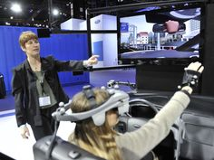 Allison Stephens (L) and Francesca Montini of Ford demonstrate how they use motion-capture technology to help engineers make design decisions before cars go into production during the Chicago Auto Show at McCormick Place on February 9, 2012 in Chicago. Ford also utilizes the same technology to simulate production tasks in order to design jobs that are less physically stressful for their workers. UPI/Brian Kersey