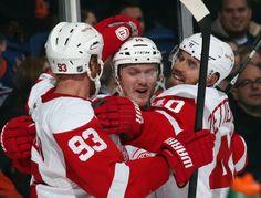 Johan Franzen #93 Gustav Nyquist #14 and Henrik Zetterberg #40 Detroit Red Wings