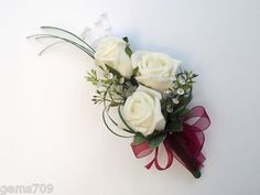 Google Image Result for http://www.weddingsflowersandgifts.co.uk/ekmps/shops/topknot/images/wedding-flowers-ladies-rose-corsage-in-ivory-and-burgundy-163-p.jpg