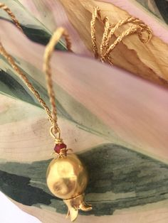 Bulbous grenade-style gold-plated pendant necklace