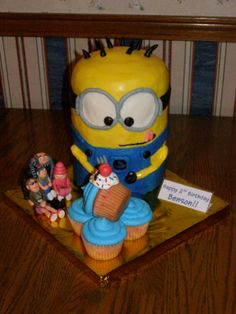 Minion Cake with Cupcakes: Felonious Gru, Edith, Agnes, and Margo were made from Chocolate Candy Clay.