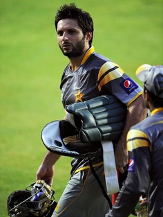 Shahid Afridi walks out for a nets session, Sharjah, August 26, 2012