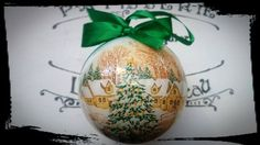 This acrylic bauble has been decorated using decoupage technique. Theme Christmas tree in the middle of a small village is a traditional Christmas theme. This type of ball can decorate the house throughout the year. The bauble main tone is golden and white and the whole is finished with a green ribbon and a green bow. The bauble can hang on a Christmas tree, be a perfect decoration of your window, Christmas dinner table or be used as a festive accent at any place you would like. It can also…