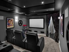 Elegant Coraline Movie Poster vogue Edmonton Transitional Home Theater Innovative Designs with black and gray carpet coffered ceiling curtains home theatre leather chairs projection screen recessed