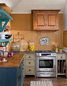 The single enclosed upper cabinet in the kitchen was hung to hide the ventilation fan