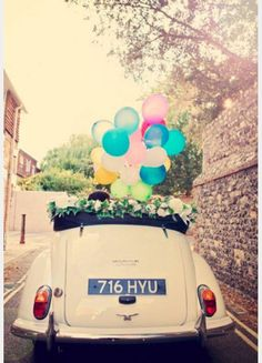 decorate your wedding getaway car with colorful balloons! ~  we ❤ this! moncheribridals.com