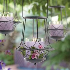 Sweeping weathered arches curve gracefully to form a fanciful metal lantern with Victorian flair. Looks breathtaking with a GloLite by PartyLite® Jar or Escential Jar,  tealights or large tealights, all sold separately. With handle: 16 1/2h, 7 3/4dia. 				 	  www.partylite.biz/cndllady
