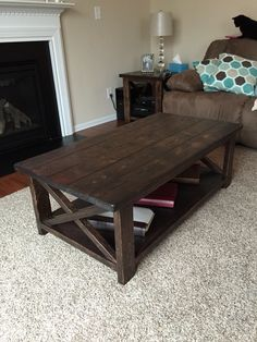 Rustic X coffee table built from Ana White plans. Assembled using Kreg Pocket Screw Jig. Distressed using an assortment of tools and chisels. Stained using Rustoleum Ultimate Kona Stain and protected with 5 coats of Rustoleum Ultimate Satin Polyurethane.