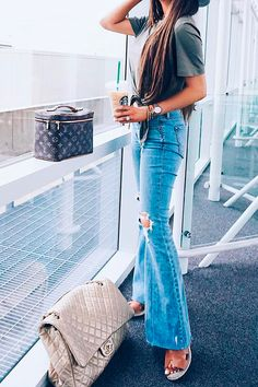 Simple, elegant and comfortable airport outfit. Blue flared/distressed jeans with a cotton plain tee, a hat and sandals. My handbag is Chanel and my nécessaire is Louis Vuitton. Emily Gemma Travel Outfits. #EmilyGemma #travelblogger #traveloutfit #airportoutfit #travel #EmilyAnnGemma