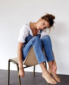 Casual weekend style inspiration: messy top knot, white top and denim overalls