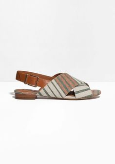 Summer-ready flat sandals featuring large shiny buckles for strapping, with an upper made from chic ribbed cotton-canvas.