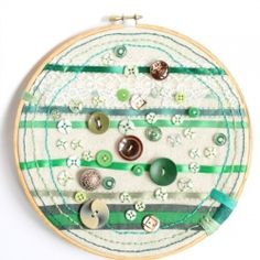 All it takes is some ribbon, a hoop and some beautiful buttons to make original art-green for St. Pat's!
