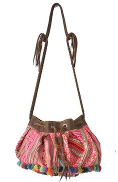 A beautiful vintage upcycled fabric HMONG handbag with pom pom's handmade in Thailand. #offbeatcuts