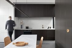 When Whiting Architects were approached to renovate a tiny Melbourne terrace on a footprint of just 96m2/1033ft2, they rose to the challenge, seeing it as an opportunity to prioritise quality over quantity. The kitchen is designed as a cohesive part of the interior, rather than a separate space, with sleek cabinetry, integrated appliances and an oven by Fisher & Paykel. Architecture by Whiting Architects. Photography by Shannon McGrath. #modernarchitecture #exteriorarchitecture #dreamhouse Integrated Fridge, Modern Home Furniture, Living Room Seating, Kitchen Tops, Black Kitchens, Open Plan Living, Minimalist Interior, Built In Storage, Beautiful Kitchens
