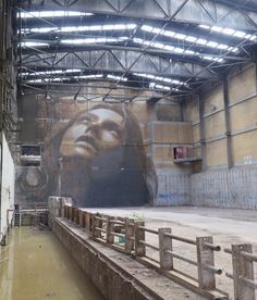 Melbourne street artist, RONE recently launched The Alpha Project – a cluster of four massive portrait murals painted secretly over three months in an large abandoned paper mill due for demolition. The mural was revealed over two days last week to a select group of invited friends. Finding the friction point between beauty and decay is a thread that runs through much of Rone's work.  #Melbourne #streetartist #RONE #AlphaProject #portraitmurals #streetart #artworks #allpublicart