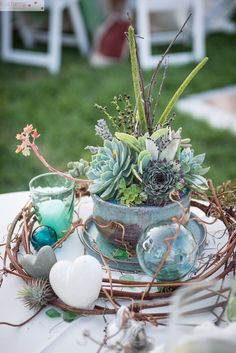 Succulent centerpiece for the sweetheart table. Ceramic pot handcrafted by a friend of the bride. Photography Bycherry