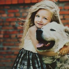 A little girl and her best friend..............