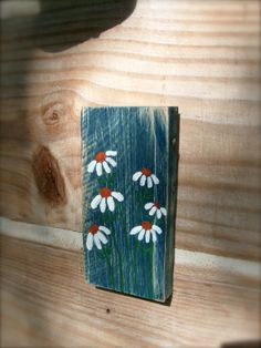 Daisies painted on blue reclaimed wood by flowersnstars on Etsy, $10.00