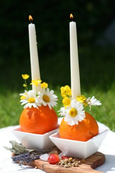 """Lovely post about traditional """"pagan"""" rituals to observe the summer solstice, using flowers and candles.  I just love this idea for using oranges as candle holders!"""
