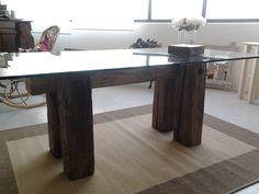 ...il primo arredo NUOVA LINEA, tavolo con struttura di travi antiche, piano in vetro temperato.  Design: Anna e Fulvio Bertinelli Produzione: Fulvio Bertinelli Laboratorio Artigiano-Assisi-