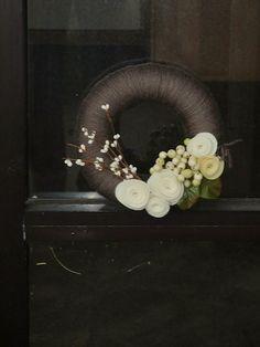 Yarn covered wreath with felt flowers