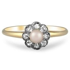 This Victorian-era ring is highlighted by an illustrious cultured pearl blossoming from a halo of rose cut diamonds for a gorgeous floral effect (approx. 0.20 total carat weight).