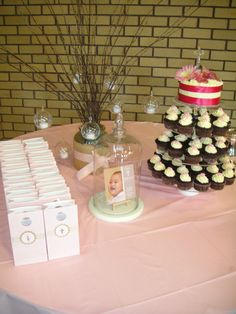 Baptism - Pink, burlap and brown.  Table decorated with branches with glass tealights, personalised candy bags, invitation in glass jar and cake and cupcakes by Jeanette Florendo.