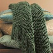 Made by knitting every row... Using large needles gives it a totally different look.