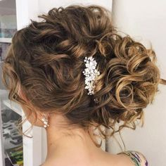 Wedding Hairstyles updo, bridal hair; Bridal Side Curly Bun Updo | 20 Soft and Sweet Curly Wedding Hairstyles: With wedding planning, there is a number of decisions a bride needs to make leading up to her big day – from flower arrangements and decorations to food catering, outfit and hair choices. But of all those choices, how to wear her hair may be the most exciting one; after all, the pictures from the …