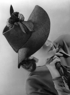 Advertisement for gloves - but look at the hat! | by dovima_is_devine_II, via Flickr