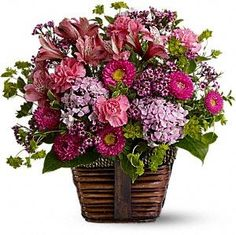 A glorious selection of fresh flowers is arranged in a rustic basket, then hand-delivered. Send someone this delightful floral gift of pretty pink blossoms and share the gift of beauty.