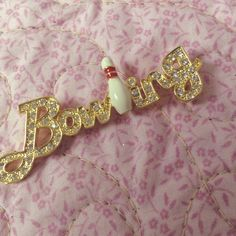 Vintage Bowling Pin Brooch With BLING Here's a charming piece of flair for any pin collector or wearer.  So cute on a hat, backpack, purse, or on a retro bowling shirt..  About 2.5 in long.  Gold tone with enamel bowling pin.  Not taking offers, thanks. Vintage Jewelry Brooches