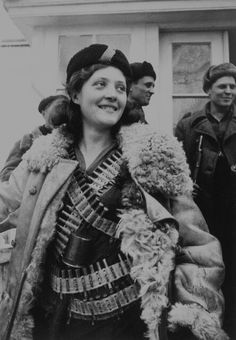 Female soviet soldier in WWII. The USSR almost instantly gave women equal rights when it was formed, as a result women could serve in their military. She was a sniper in Stalingrad, and supposedly a machinegunner at Kursk.