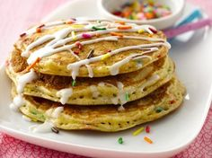 Happy Birthday Pancakes - serve these on your child's birthday! 1 cup Original Bisquick® mix, 1 cup Betty Crocker® SuperMoist® yellow cake mix,  3 tablespoons candy sprinkles, 1 cup milk, 1 teaspoon vanilla, 2 eggs. Glaze: 2 1/2 cups powdered sugar, 3 tablespoons plus 2 teaspoons milk, 1 teaspoon vanilla, Additional candy sprinkles.