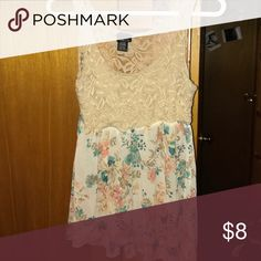 Floral tank Cute fitted top floral tank, with a loose fitting sheer bottom. Great condition! Rue 21 Tops Tank Tops