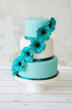 Gorgeous three tier cake in Tiffany blue and white with cascading sugar flowers