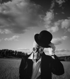 doff the hat, gentleman in gas mask still has time for pleasantries