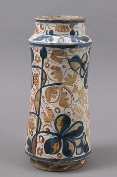 Pharmacy Jar Date: second half 15th century Geography: Made in Manises, Valencia, Spain Culture: Spanish Medium: Tin-glazed earthenware Dimensions: Overall: 11 13/16 x 5 1/2 in. (30 x 14 cm) Classification: Ceramics Credit Line: The Cloisters Collection, 1956 Accession Number: 56.171.85