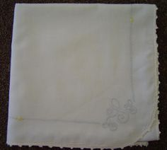 Shadow work Blanket.  White Swiss Nelona top and blue flannel lining. Crocheted picot edging.